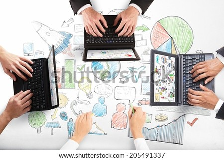 Teamwork works about a new project in a desk - stock photo