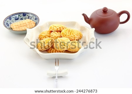 Teapot and cookie food background. - stock photo