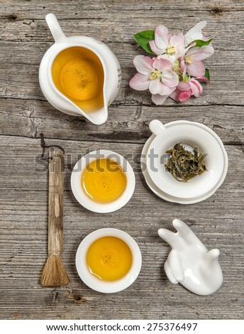 Teapot and cups on rustic wooden table. Utensils for traditional chinese tea ceremony - stock photo