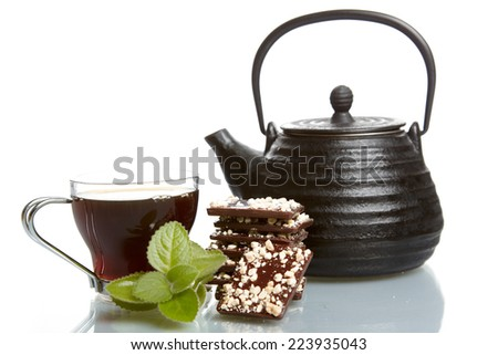 teapot, cup and and chocolate - stock photo