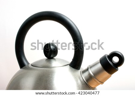 Teapot whistling Old kettle on Table - stock photo