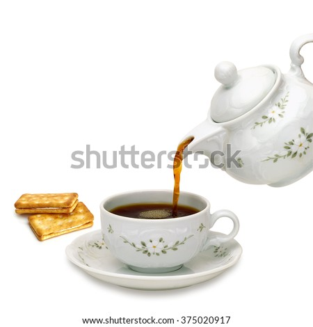 Teapot with biscuits on white background - stock photo