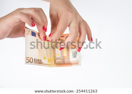 tear banknote - stock photo