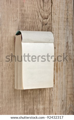 tear-off calendar on a wooden background - stock photo