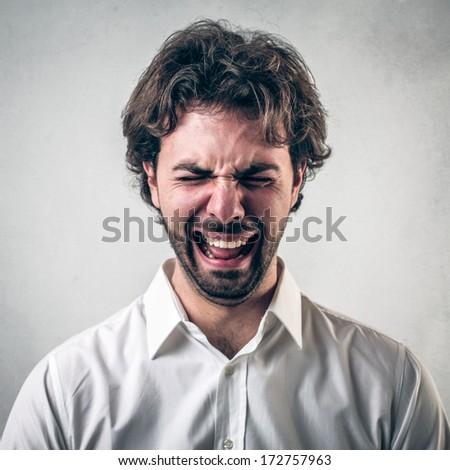 tearing guy - stock photo