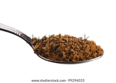 Teaspoon with granulated instant coffee isolated on white - stock photo