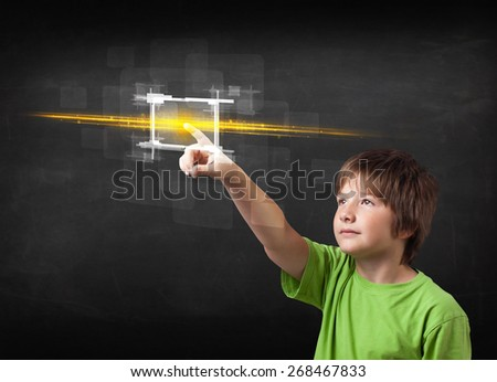 Tech boy touching button with orange light beams concept  - stock photo