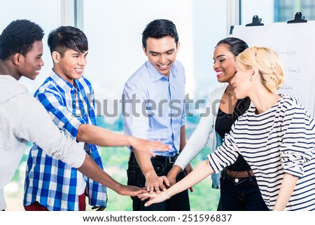 Tech entrepreneurs with team spirit and motivation - stock photo