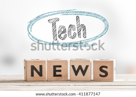 Tech news sign in a bright room on a table - stock photo