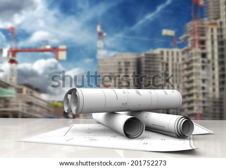 technical blueprints on white table in a construction site - stock photo
