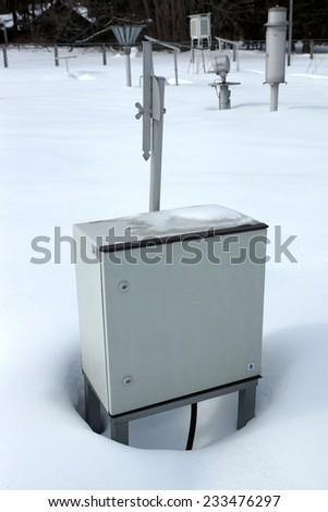 Technical metal box on snow. - stock photo