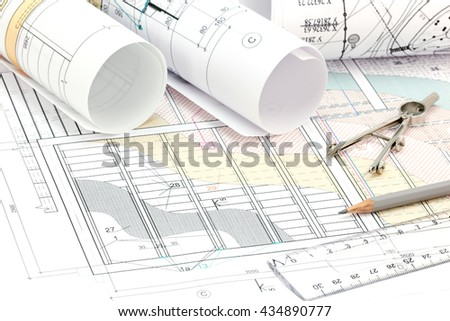 technical project drawings, rolls of blueprints and drawing tools - stock photo