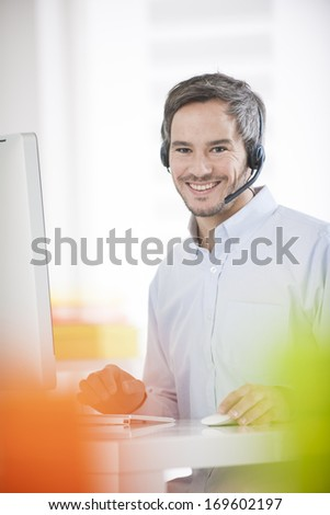 technical support operator working on computer - stock photo