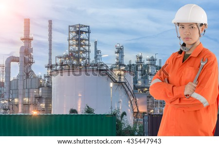 technician and Oil Refinery petrochemical plant in night, Industry Petrochemical plant in sunshine, overall  an oil and gas refinery, heavy industry, Internal structure of large thermal power plant - stock photo