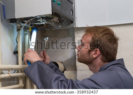 Technician controlling the heating system - stock photo
