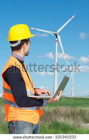 Technician Engineer in Wind Turbine Power Generator Station,italy - stock photo