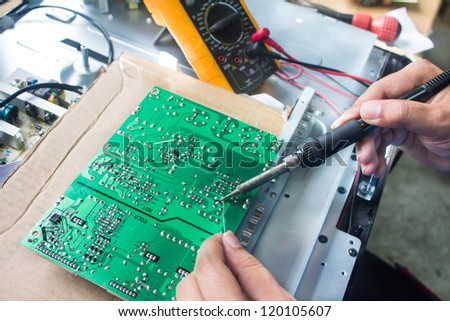 Technician repairing  a television. - stock photo