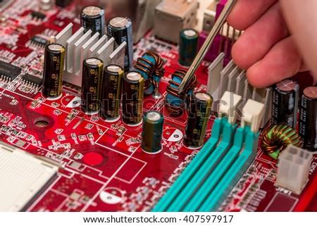technician's hand assembling personal computer - stock photo