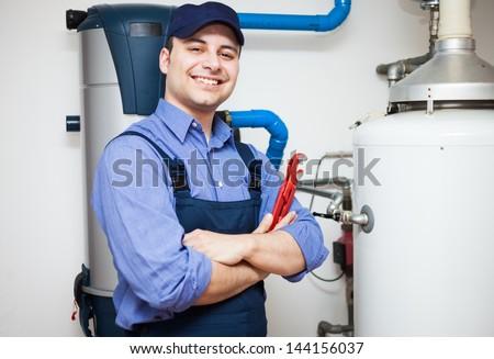 Technician servicing an hot-water heater - stock photo