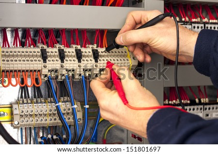 Technician testing a control panel - stock photo