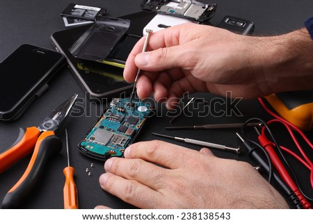Technician to work in cellular repair faults - stock photo