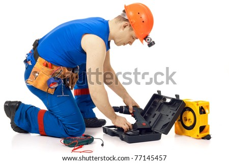 Technician with instrument after job against white background - stock photo