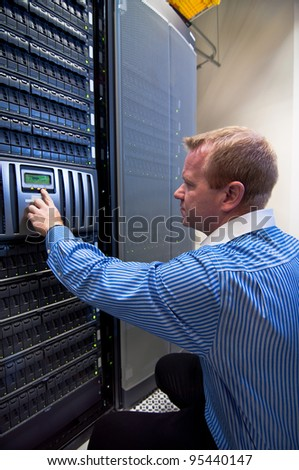 Technician working on a large scale Storage server (SAN/NAS). - stock photo