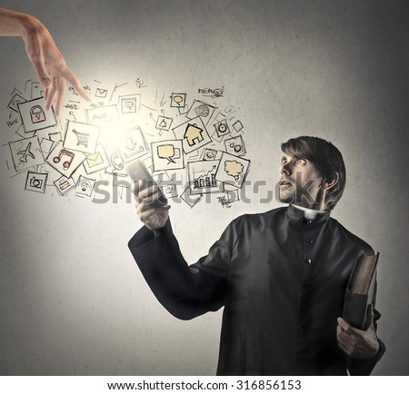 Technological priest - stock photo