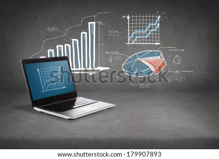 technology and advertisement concept - laptop computer with graph on screen - stock photo