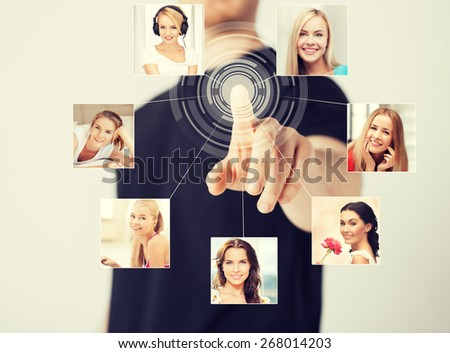 technology and communication - man pressing button on virtual screen with contact icons - stock photo
