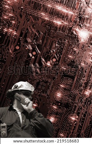 technology and engineering, large circuit-board and hard-hat engineer - stock photo