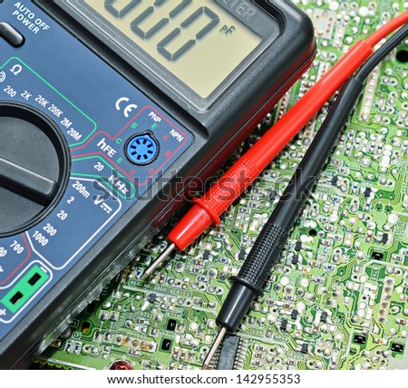 Technology background, digital multimeter close up - stock photo