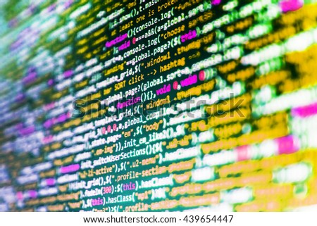 Technology background. Source code photo. Website development. Computer program. Software development. Programmer occupation. Computer script.  Developer working on websites codes in office.    - stock photo