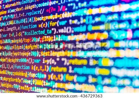 Technology background. Website development. Software development. Monitor photo. Writing program code on computer. Programmer occupation. Programming code on computer screen. Software source code.   - stock photo
