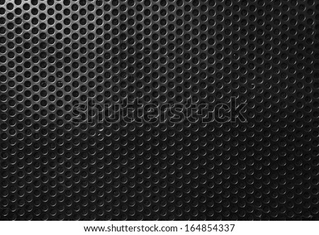 Technology background with seamless circle perforated carbon spe - stock photo