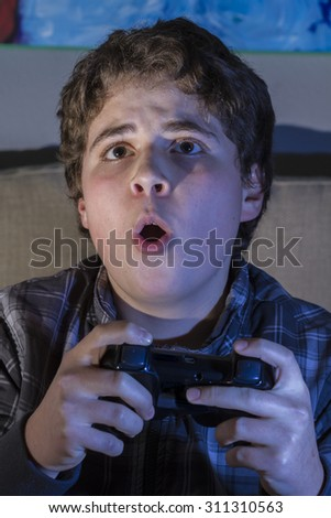 Technology. boy with joystick playing computer game at home. - stock photo