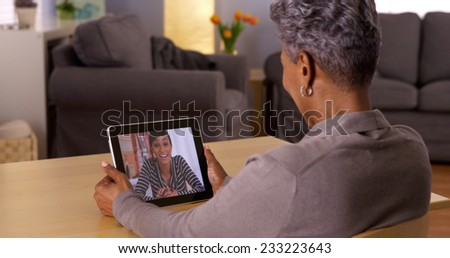 Technology bringing loved ones together - stock photo