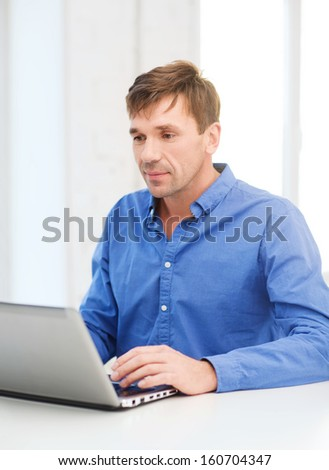technology, business and lifestyle concept - man working with laptop at home - stock photo