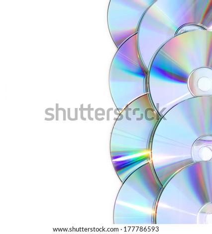 Technology, computer background with CD. Disks are isolated on white - stock photo