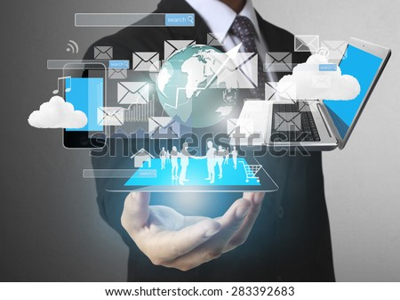 Technology in the hands of businessmen - stock photo