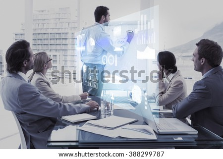 Technology interface against young business people in board room meeting - stock photo