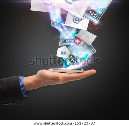 technology, internet and application concept - hand holding smartphone with icons - stock photo