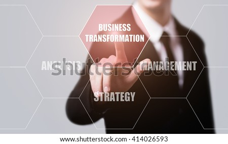 technology, internet and modern business concept. Businessman pressing business transformation button on virtual screens with hexagons and transparent honeycomb - stock photo