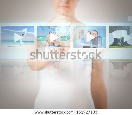 technology, internet and networking concept - woman pressing button on virtual screen - stock photo