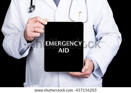 technology, internet and networking in medicine concept - Doctor holding a tablet pc with emergency aid sign. Internet technologies in medicine and tourism - stock photo