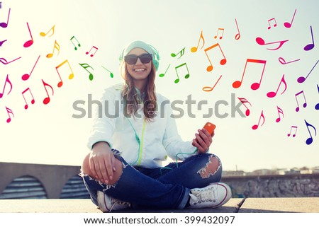 technology, lifestyle and people concept - smiling young woman or teenage girl with smartphone and headphones listening to music outdoors over colorful musical notes background - stock photo