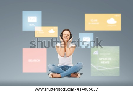 technology, music and happiness concept - smiling young woman or teen girl in headphones over virtual screens and web applications on gray background - stock photo
