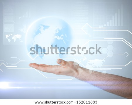 technology, news and environment concept - man hand holding virtual sphere globe - stock photo