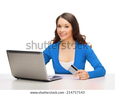 technology, online shopping and payment concept - smiling woman with laptop computer and credit card - stock photo