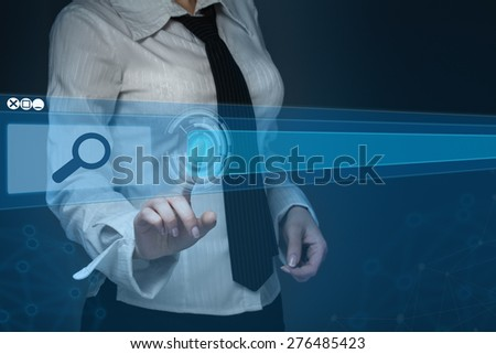 technology, searching system and internet concept - businesswoman hand pressing Search button - stock photo